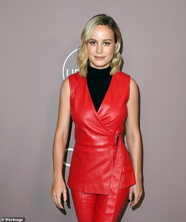 Brie Larson Star of Lessons in Chemistry in Red Leather Jumpsuit