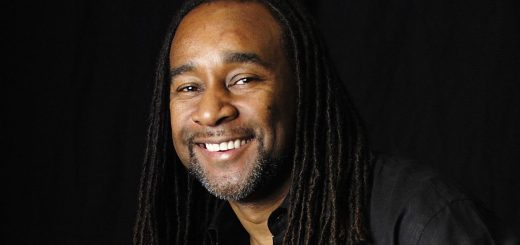 Author Eric Jerome Dickey with a black background