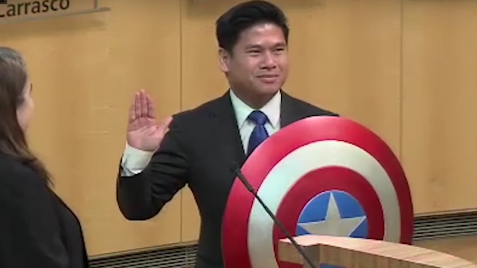 Lan Diep being sworn in with Captain america shield