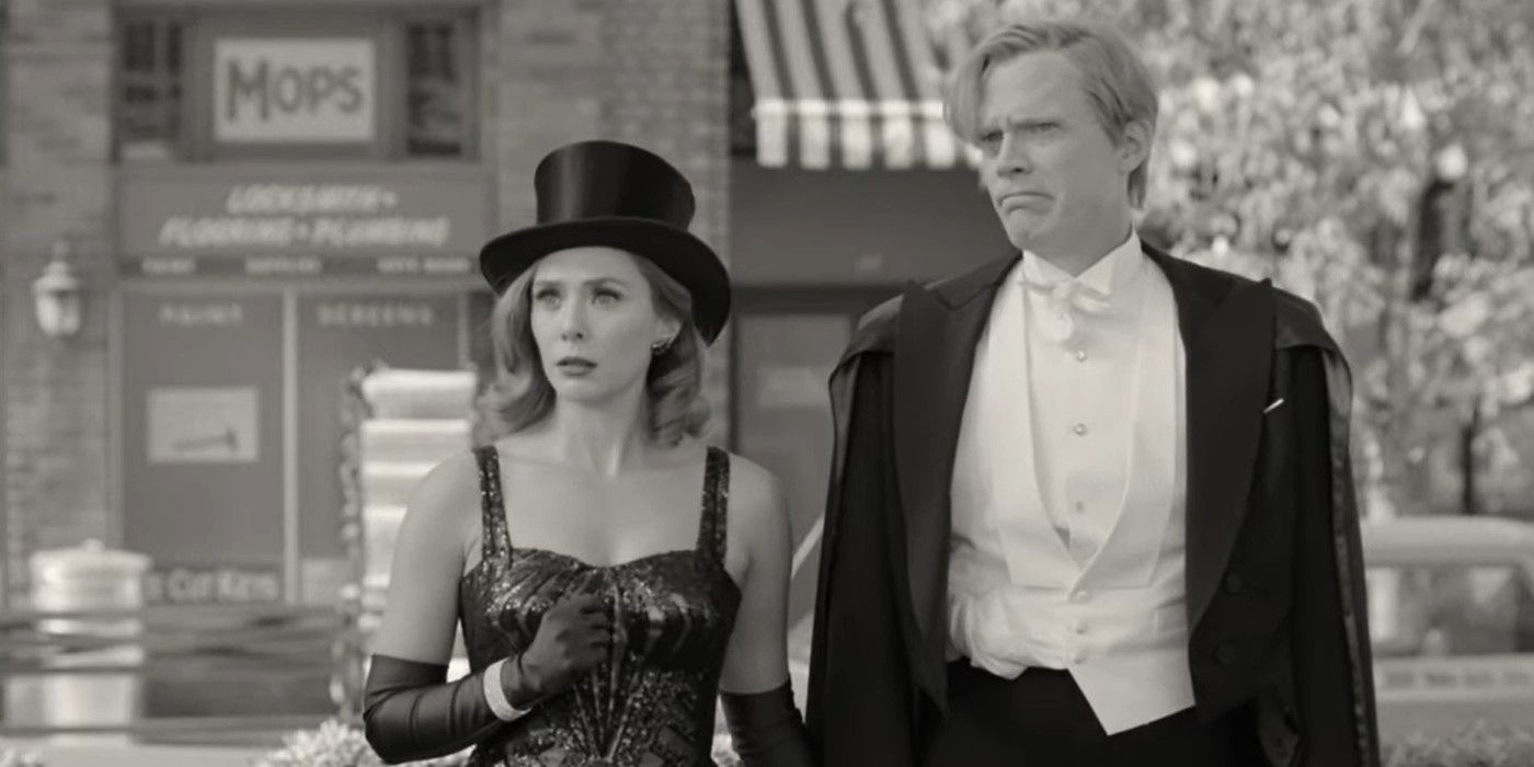 Elizabeth Olsen in black leotard with Paul Bettany