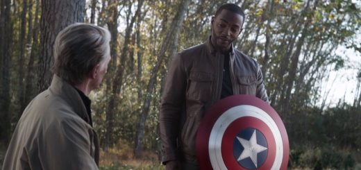 captain america passes shield to falcon