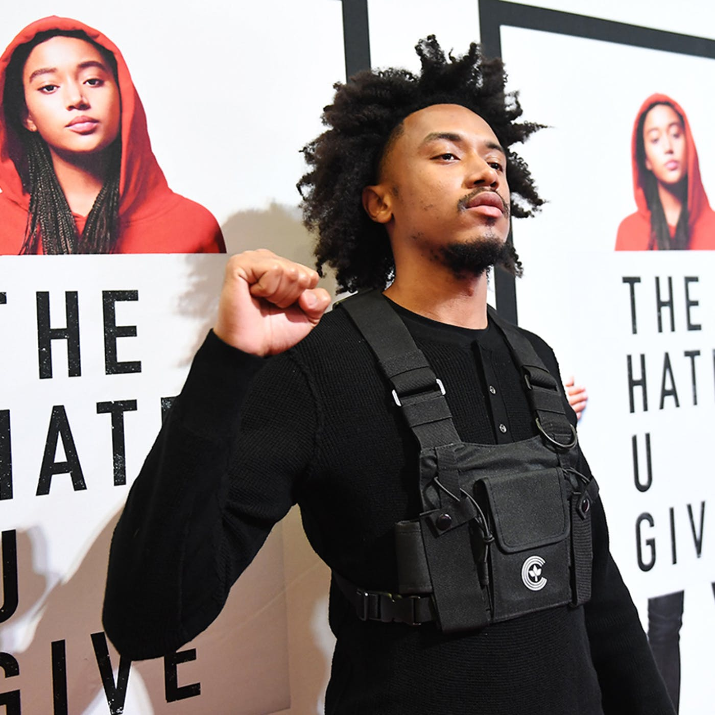 Bobby Sessions in front of poster for The Hate U Give