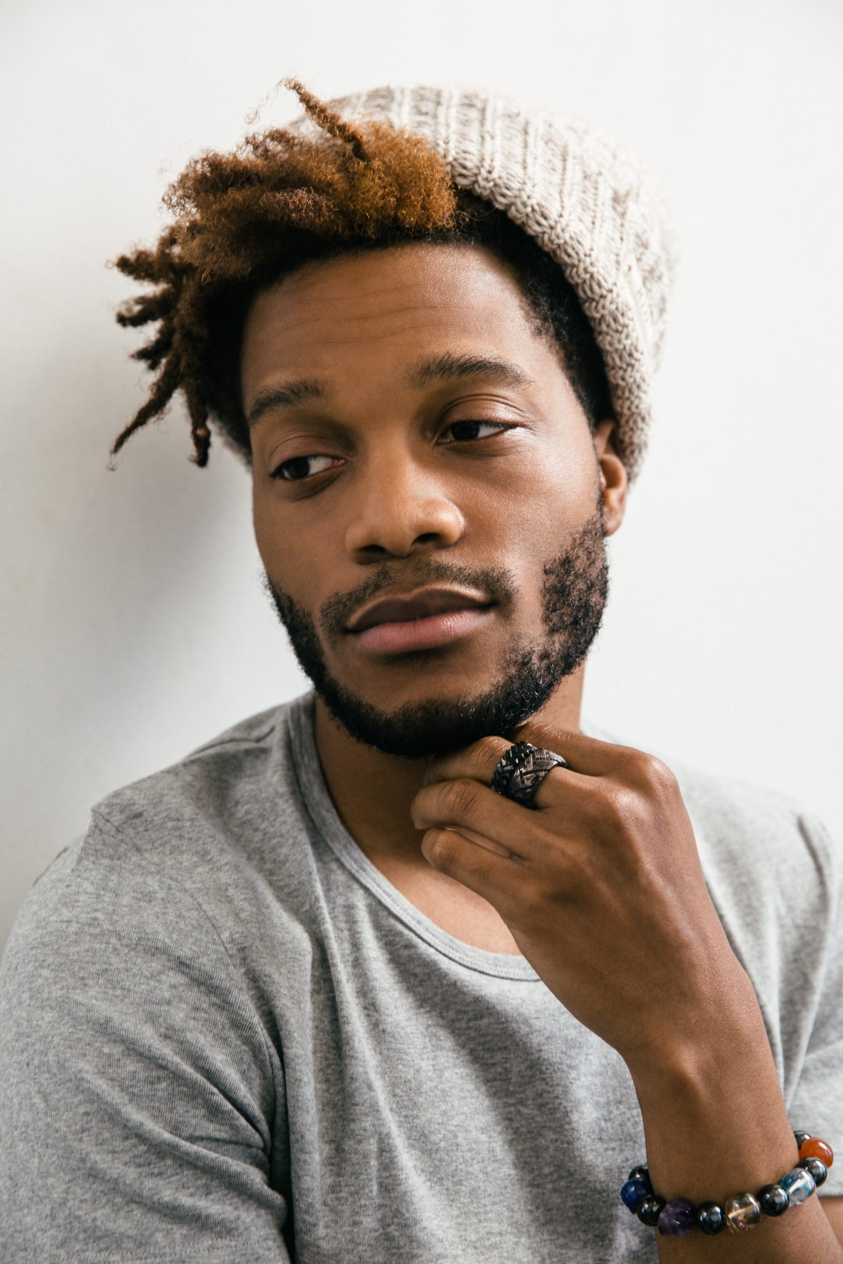 Jermaine Fowler in white beanie for GQ