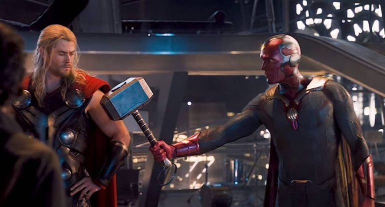 Vision holding Thor's hammer in Age of Ultron