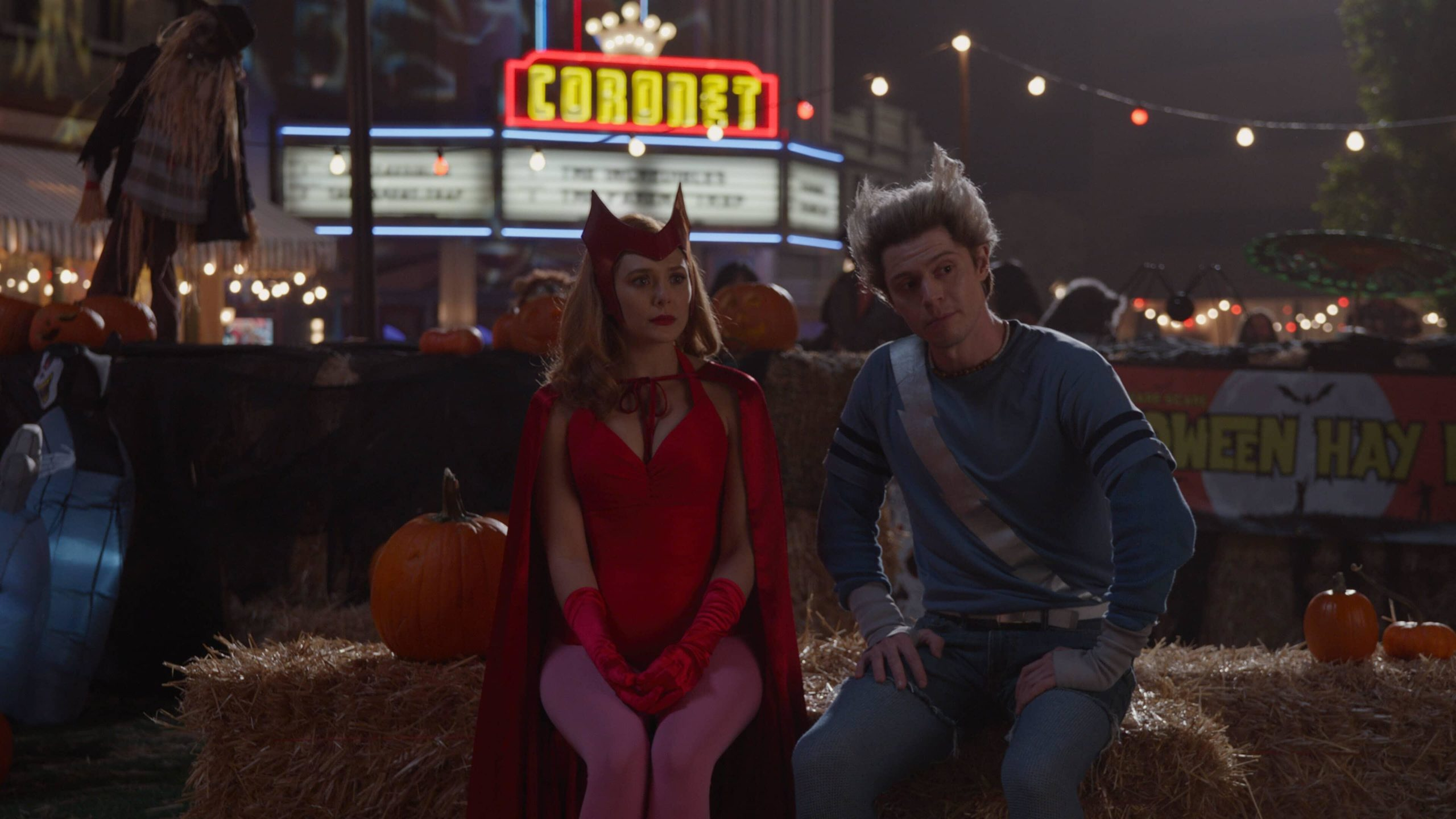 Elizabeth Olsen dressed as classic Scarlet Witch and Evan Peters dressed as classic Quicksilver