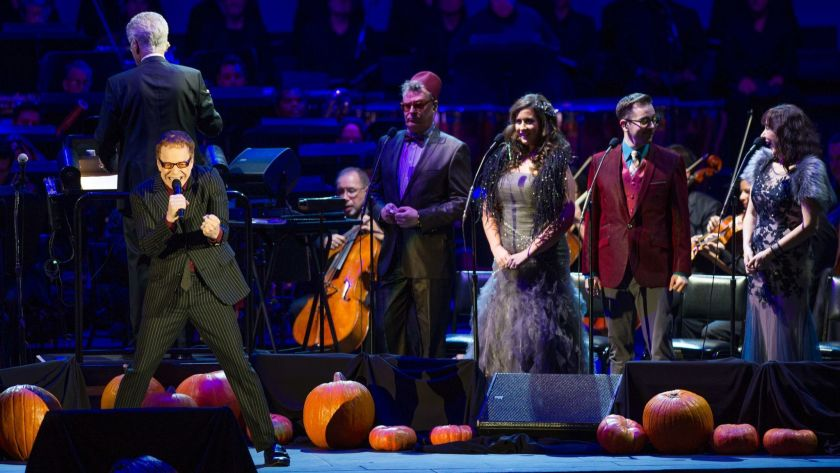 """Danny Elfman sings with the chorus during a """"Nightmare Before Christmas"""" concert at the Hollywood Bowl"""