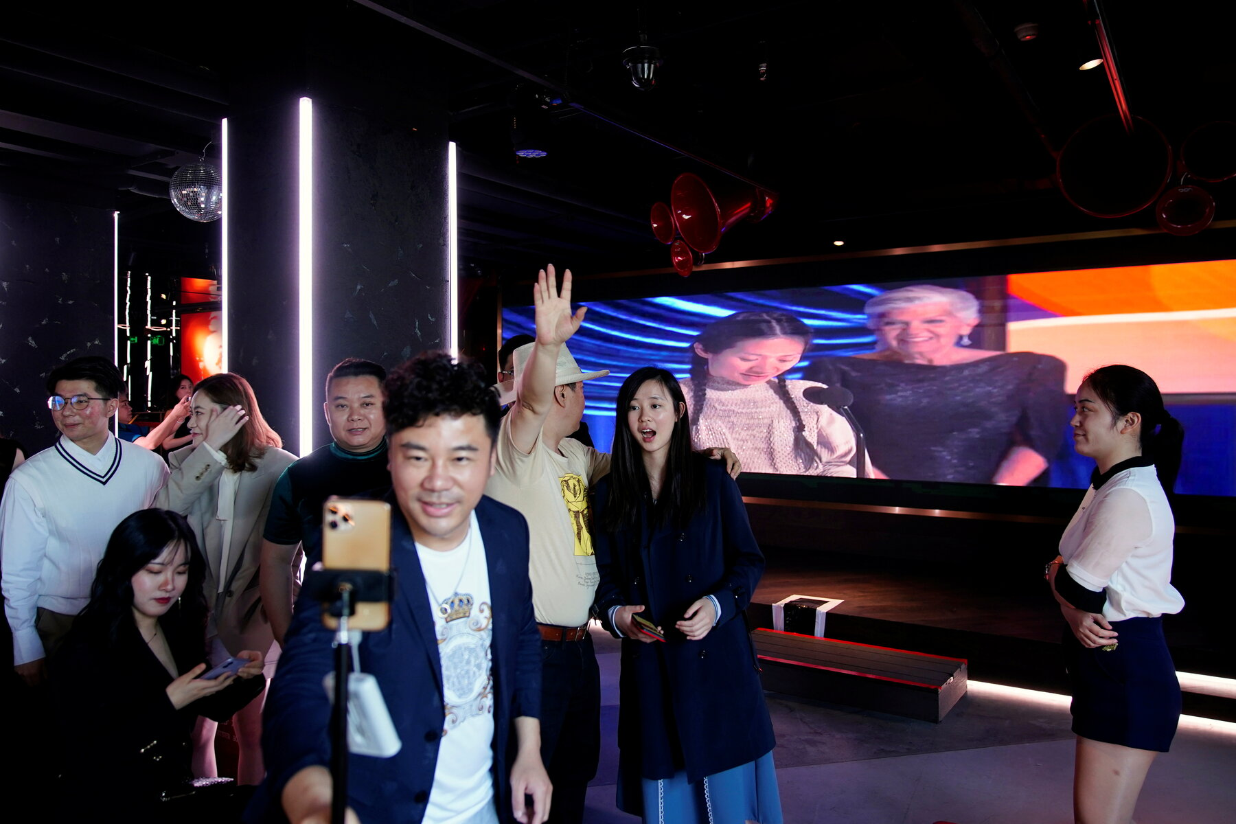 A screening of the Academy Awards, hosted by the Alumni Society of New York University, at a bar in Shanghai